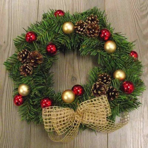 Picture of Christmas Wreath diam. cm 30 (11,8 inch) green plastic PVC with natural decorations, red berries and cones