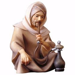 Picture of Sitting Shepherd with pipe cm 25 (9,8 inch) hand painted Comet Nativity Scene Val Gardena wooden Statue traditional Arabic style