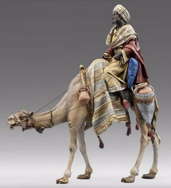 Picture of Balthazar Black Wise King on Camel cm 10 (3,9 inch) Immanuel dressed Nativity Scene oriental style Val Gardena wood statue fabric clothes