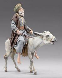 Imagen de Pastor anciano en burro  cm 12 (4,7 inch) Pesebre vestido Immanuel estilo oriental estatua en madera Val Gardena trajes de tela