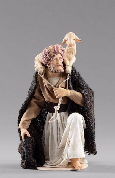 Picture of Kneeling Shepherd with lamb cm 40 (15,7 inch) Hannah Orient dressed nativity scene Val Gardena wood statue with fabric dresses
