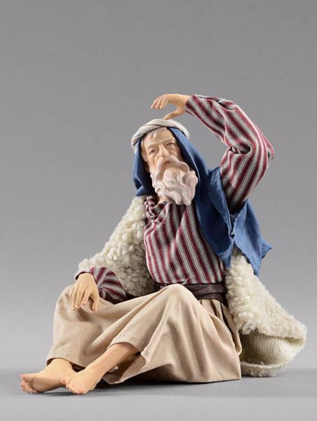 Picture of Shepherd looking cm 20 (7,9 inch) Hannah Orient dressed nativity scene Val Gardena wood statue with fabric dresses