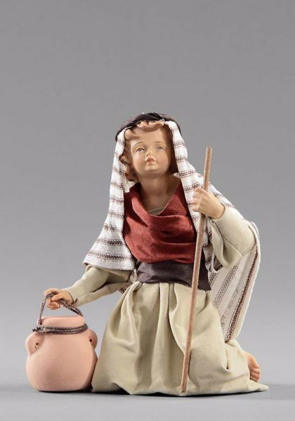 Imagen de Niño arrodillado con jarra cm 30 (11,8 inch) Pesebre vestido Hannah Orient estatua en madera Val Gardena con trajes de tela