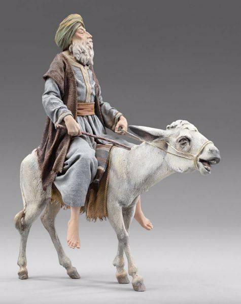 Picture of Elderly Shepherd on donkey cm 20 (7,9 inch) Immanuel dressed Nativity Scene oriental style Val Gardena wood statue fabric clothes