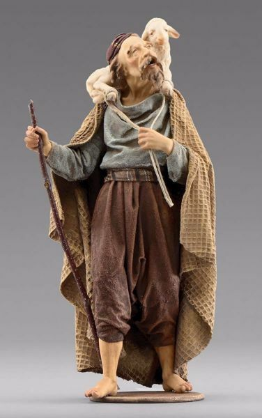 Picture of Shepherd with lamb cm 20 (7,9 inch) Immanuel dressed Nativity Scene oriental style Val Gardena wood statue fabric clothes