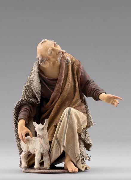 Picture of Kneeling Shepherd with lamb cm 20 (7,9 inch) Immanuel dressed Nativity Scene oriental style Val Gardena wood statue fabric clothes