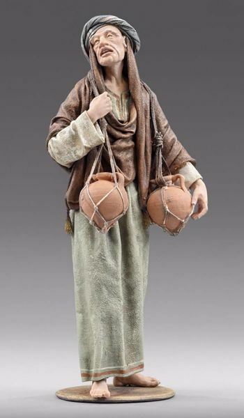Imagen de Pastor de pie con ánforas cm 30 (11,8 inch) Pesebre vestido Immanuel estilo oriental estatua en madera Val Gardena trajes de tela