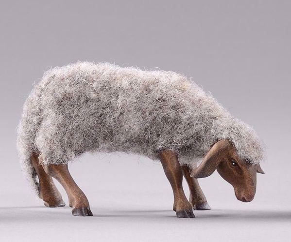 Immagine di Pecora con lana che bruca cm 12 (4,7 inch) Presepe da vestire Omobono in legno e rame